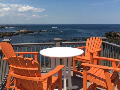 Second floor ocean front deck with adirondack chair seating.