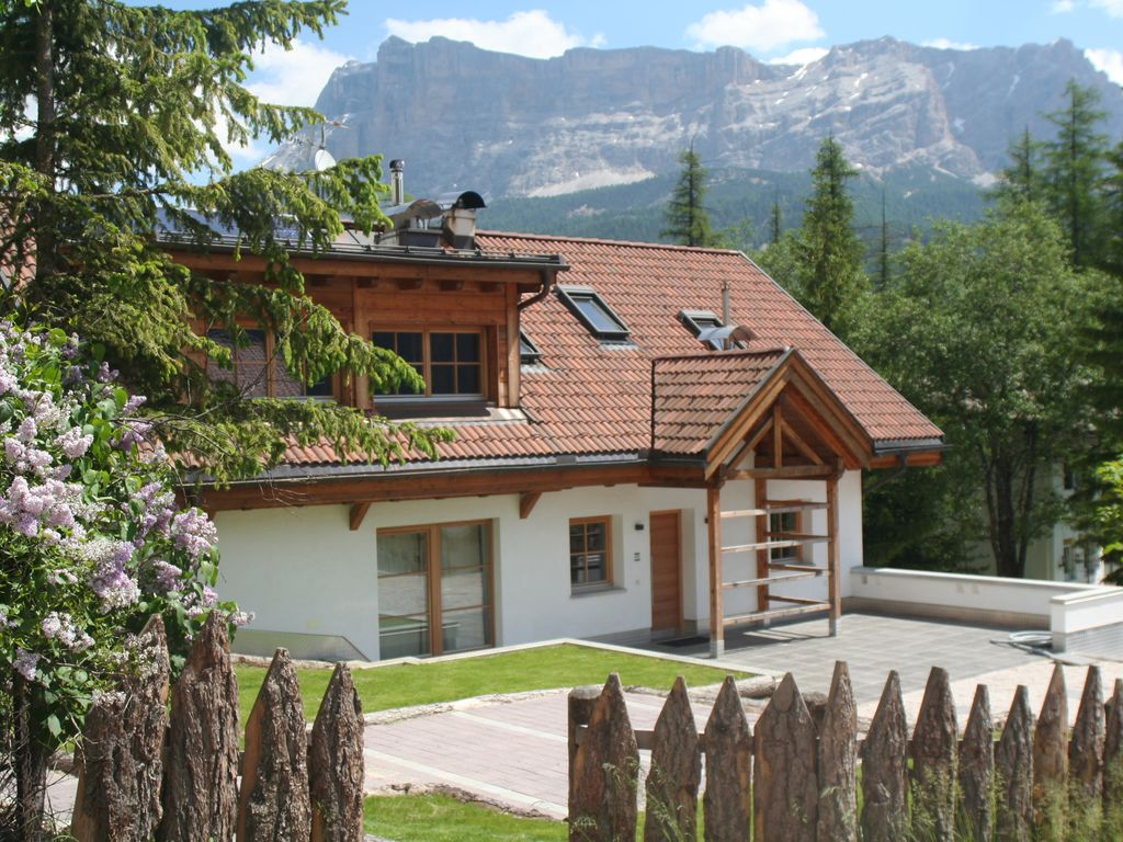casa zilli dolomites chalet recently completely refurbished la villa chalet rental casa zilli summer front view from outside the garden
