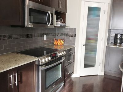 Spacious Kitchen with Pantry and stainless steel appliances.