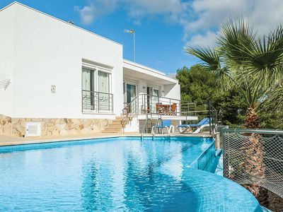 Photo for 4 bedroom Villa, sleeps 8 in Arenal d'en Castell with Pool, Air Con and WiFi