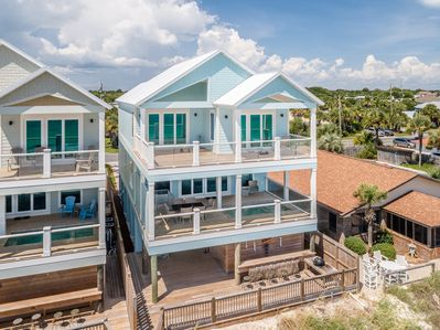 It sleeps 22 guests, has a private pool, and is just steps from the beach.