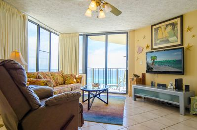 The great room has windows everywhere for magnificent beach views everywhere you look.