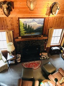 Relax with a warm fire in cozy log cabin after a day of hiking or site seeing