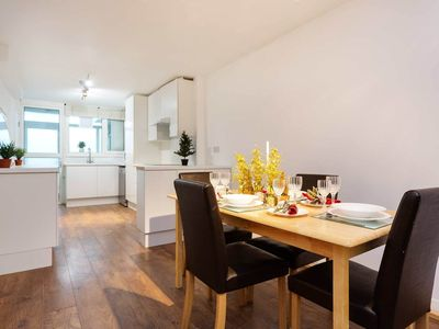 Photo for Modern Chelsea 3 bed garden flat, close to the King's Road, sleeps 7, by Veeve