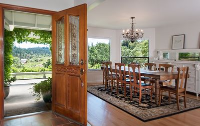 Front door entryway and dining room with sweeping vineyard views.