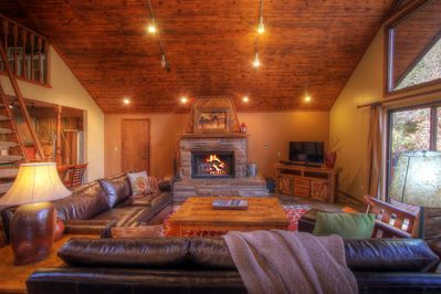 Cozy living room with wood burning fireplace. Seating for 7.