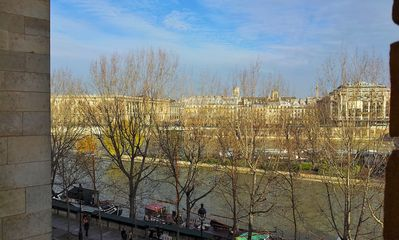 View from the apartment on Pont Neuf bridge, Seine River and boats