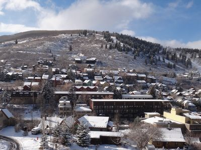 Panoramic views of the Park City Mountain Resort from two decks with hot tub.