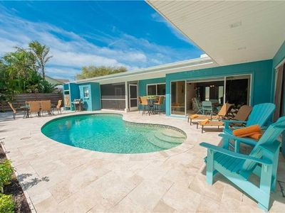 Photo for Beach Haven: Ground Level, Heated Pool, Ping Pong Table, Close to the Beach!