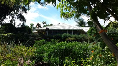 Tucked away in the World Botanical Gardens is the amazing Garden Home on 3 acres