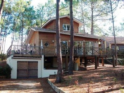 Photo for Pleasant wooden chalet located in a hamlet in the heart of the pine forest in a quiet