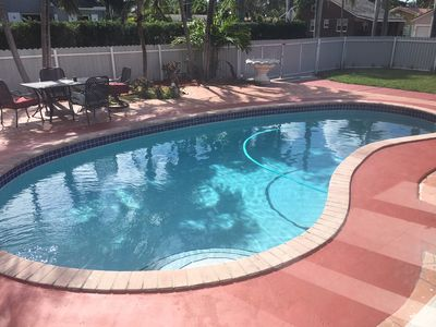 Photo for STUNNING GRAND POOL HOUSE WALKING DISTANCE TO THE BEACH