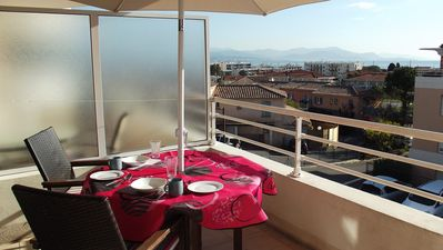 Dine in style on the balcony with fabulous views of Nice, the Med. and the Alps.