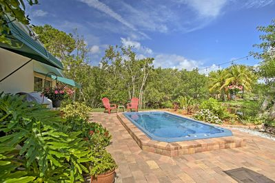 The 2BR, 2-bath beach bungalow features a swim spa and furnished patio.