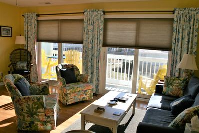Sunny and bright with double sliding glass door with shades.