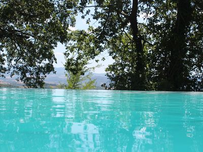 Photo for Amazing villa with infinity pool and view over Todi