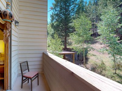 Photo for NEW LISTING! Mountain decor condo w/ forest views & easy snowboard access!