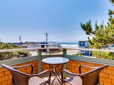 Photo for Cozy cottage with ocean views, elevated deck, close beach access!