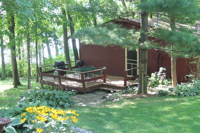 View of deck and entrance to cabin.