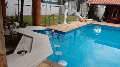 Photo for HOUSE IN CONDOM 6 SUITES, BAR IN POOL, CAMP, SALON GAMES 400 METERS BEACH