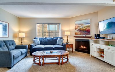 Photo for Spacious upper rear oceanfront unit just steps from the Balboa Pier fun!