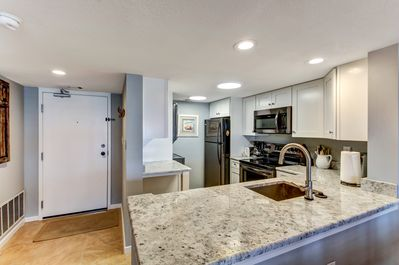 Luxurious Upgraded Kitchen Featuring Gorgeous Granite Counters and Brand New Stainless Steel Appliances