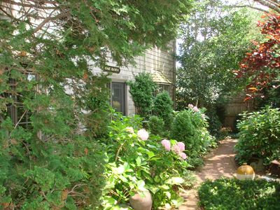 Photo for Beautifully restored antique carriage house, in town location, walk to beach