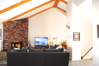 Enjoy the vaulted ceilings, SMART HDTV and brick fireplace in the family room.