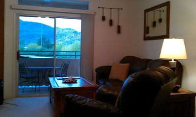 Mountain views and private balcony from the living room.