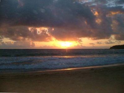 Sunrise in the eastern sky, with soft trades and rolling waves.