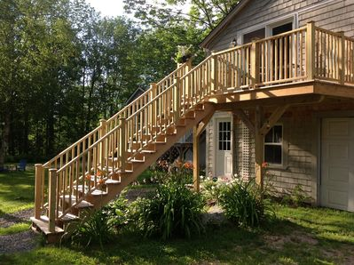 New deck above expanding flower garden!