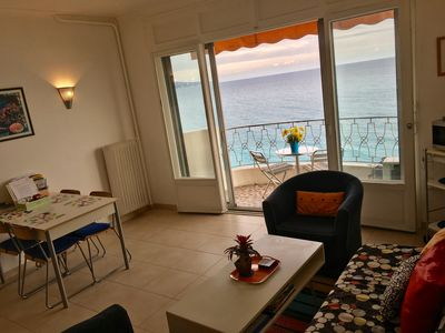 The main living area with table for four, futon and two chairs . . .AND the VIEW