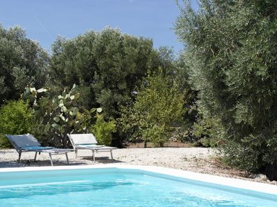 Photo for Secluded country chic Trulli with private pool and garden near Ostuni centre
