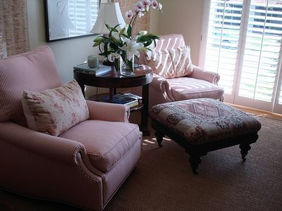 Sitting room with another flatscreen TV. Great for reading and sunny warmth