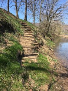 This picture  shows steps leading up to campsite from river