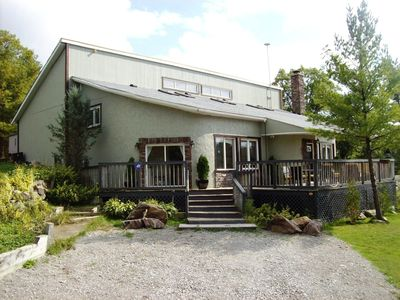Features 19 Foot Vaulted Ceilings, Massive Stone Fireplace, Bunkie, Sleeps 10.