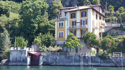 Photo for Exclusive apartment directly on Lake Maggiore with private lake access