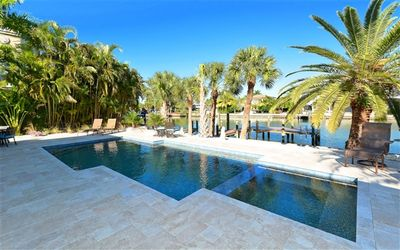 Photo for St. Armand's Canal-front Pool Home ~ freshly remodeled and steps to the beach!