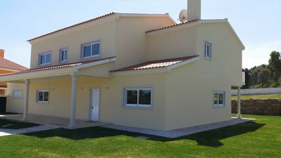 Front of villa with end of wheelchair access to front door showing