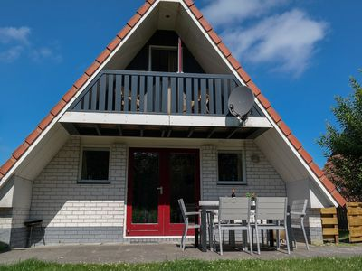 Photo for 6pers. Waterfront house on a typical dutch canal, by Lauwersmeer