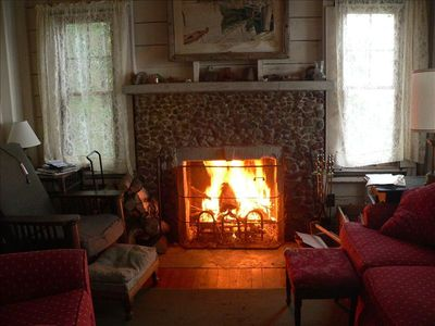 Living room and fireplace on a cool fall day.