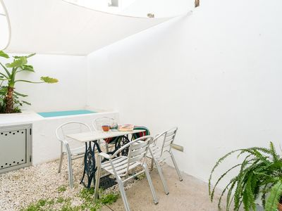 Photo for Apartment with pool and private patio. Downtown