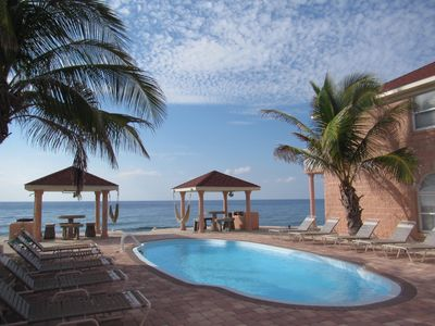 Relax by the pool or the Caribbean Sea