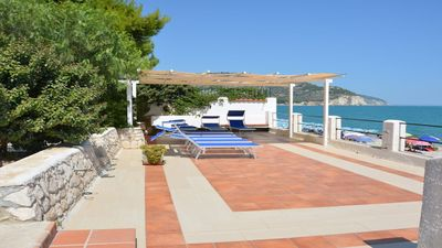 Photo for The terrace with direct access to the beach