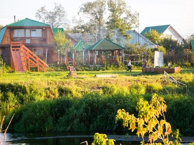 Photo for Authentic wooden house with a classic Russian bathhouse right at own river beach