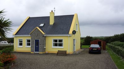 Photo for 4 Bedroom Holiday home in village of Carrigaholt, sleeps up to 10