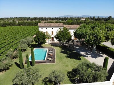 Photo for Large typical Provencal farmhouse, surrounded by vineyards, 5 bedrooms with bathroom, swimming pool