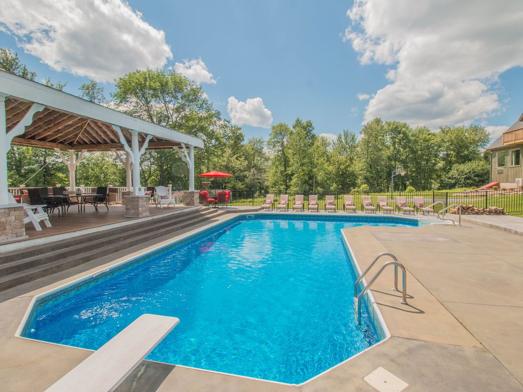 The majestic hilltop mansion private rd pool movie theater game rm guest house beach lake for Pocono rental with private swimming pool