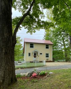 New windows (2020) and a new white picket fence add to the cottage  charm.