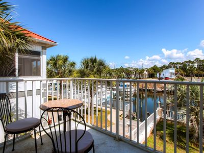 Photo for Enjoy canal views, a dock, shared pool access - walk to beach, snowbirds welcome